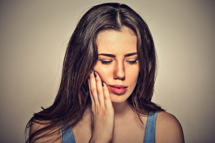 young girl with tooth pain