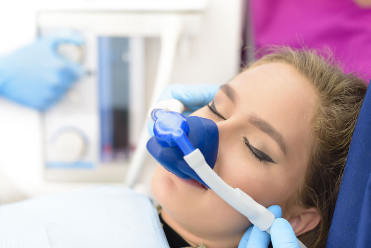 Young woman getting a sedation dentistry